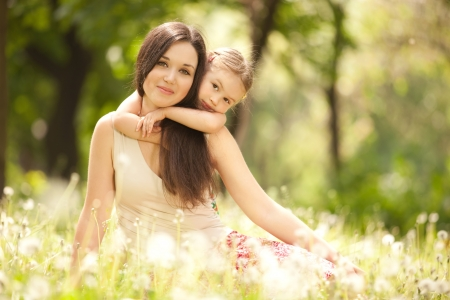 Mother and daughter in the park photo