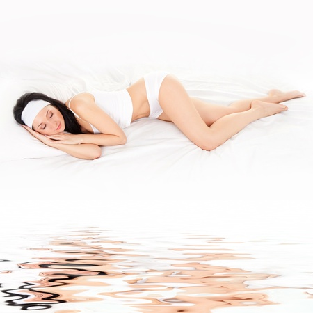 mattress: Cute woman sleeps on the white bed