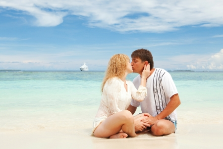 Young couple on the beach of sea photo