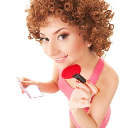 Fun woman with brush for makeup on the white background photo