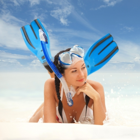 fin: Happy woman with snorkeling equipment on the beach