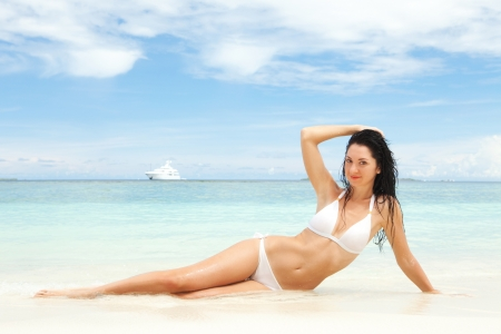 sexy body: Happy young woman rest on the beach