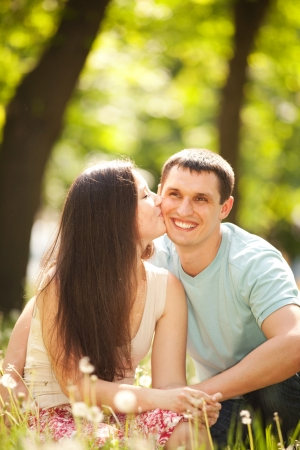 boyfriend: ung happy couple kissing in the park Stock Photo
