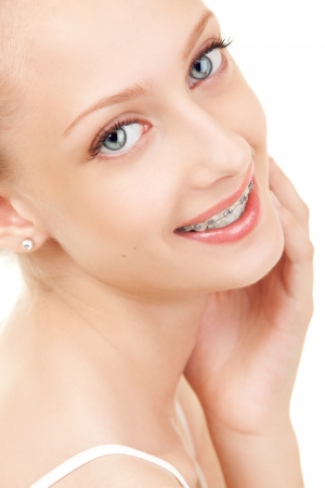 cute braces: Cute girl in braces on white background Stock Photo