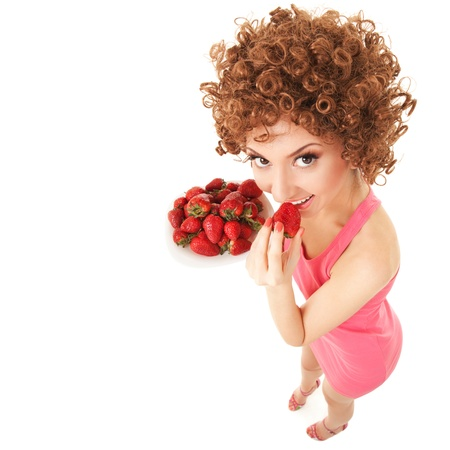 useful: Fun woman with strawberry on the white background