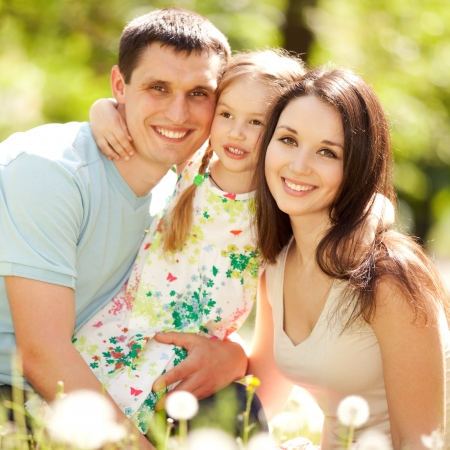 children happy: Happy mother, father and daughter in the park