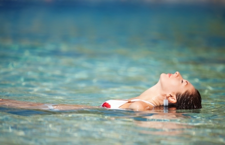 Young woman relaxing in the water photo