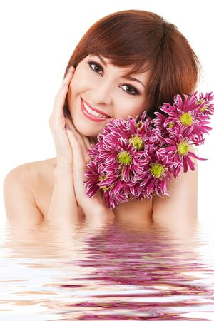 Cute young woman with flowers photo
