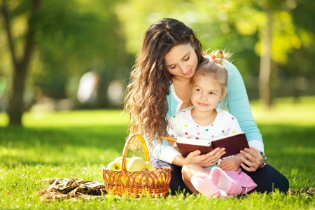 family park: Mother with daughter in the park Stock Photo