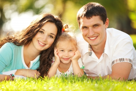 child couple: Happy mother, father and daughter in the park