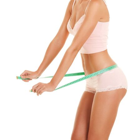 weight loss success: happy woman with measure tape Stock Photo