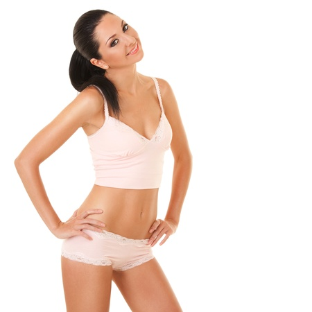 loose skin: Pretty tanned woman in lingerie isolated on white background