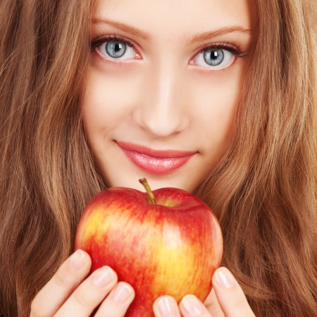 Portrait of a young woman with red apple photo