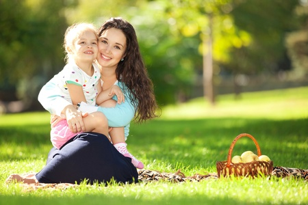families together: Mother with daughter in the park Stock Photo