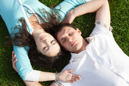 Happy couple relaxing on green grass Stock Photo - 16694587