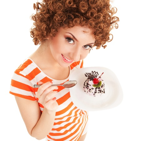 beautiful smile: fun woman eating the cake on the white background
