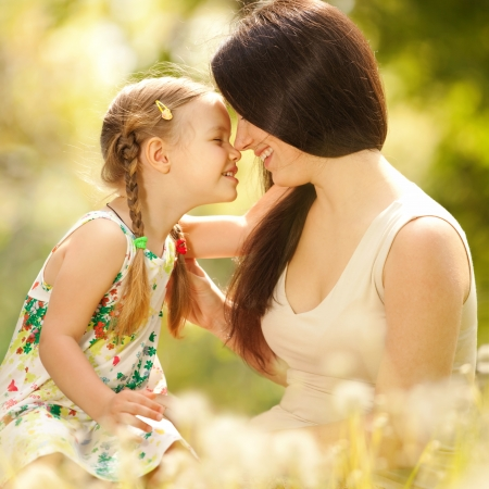 human relationships: Mother and daughter in the park Stock Photo