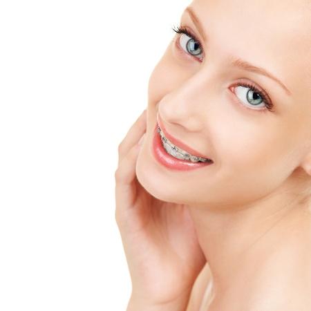 Cute girl in braces on white background Zdjęcie Seryjne