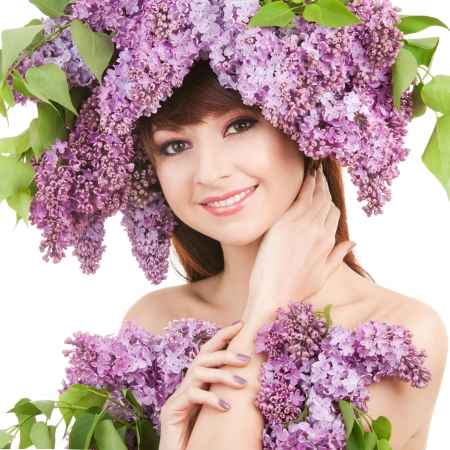 Young woman with lilac flowers Stock Photo - 16969580