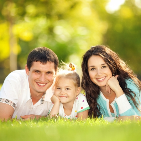 family fun day: Happy mother, father and daughter in the park
