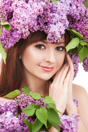 Young woman with lilac flowers Stock Photo - 17038642