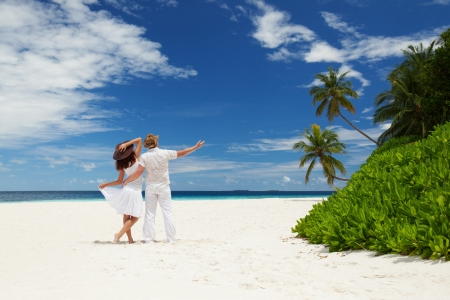 honeymoon couple: Young couple on the beach of sea