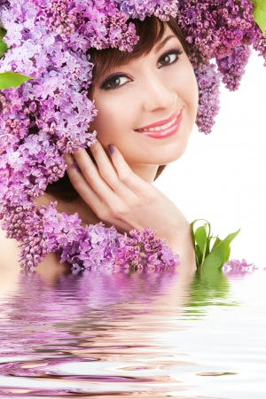 Young woman with lilac flowers photo