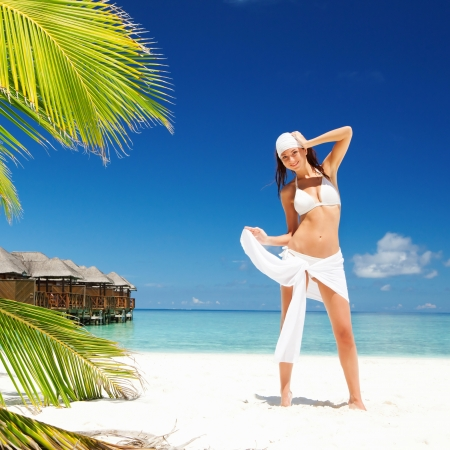 bikini island: Happy woman on the tropical beach