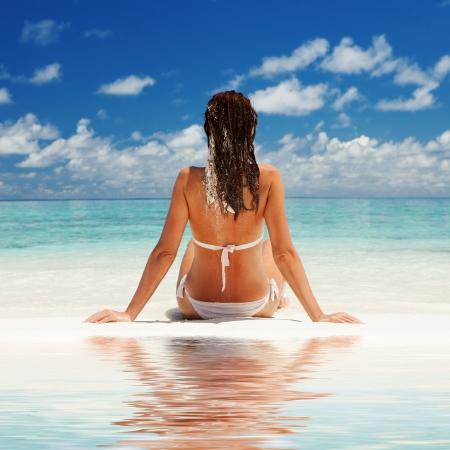 siting: Cute woman relax on the summer beach