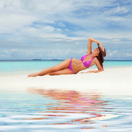 Cute woman relaxing on the beach photo