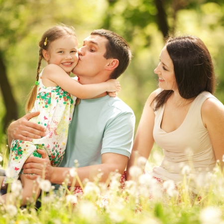 joy of life: Happy mother, father and daughter in the park
