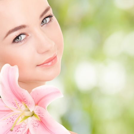 Cute woman with flower photo