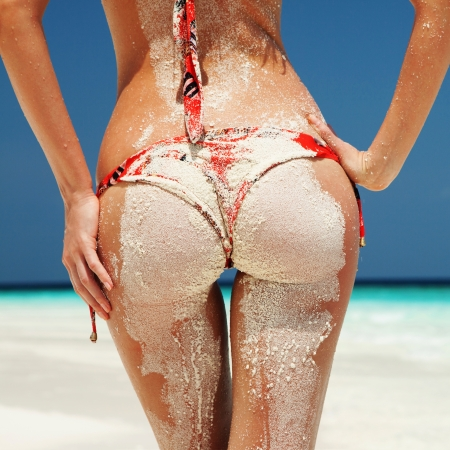 nude sexy girl: Sexy sandy woman buttocks on the beach background