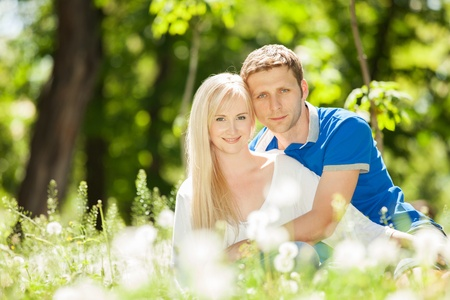 Young happy couple in the park photo