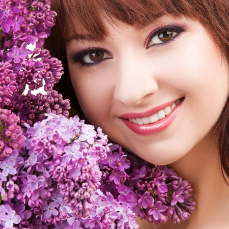 Young woman with flowers on white background photo
