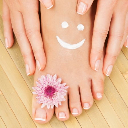 foot massage: Care for beautiful woman legs