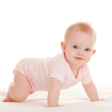 Baby on the white bed photo