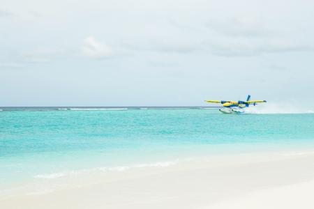 plane landing:  Sea plane landing on sea Stock Photo