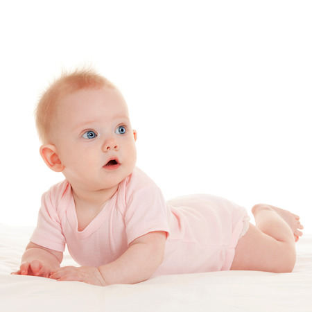 Cute baby with beautiful blue eyes on the white background photo