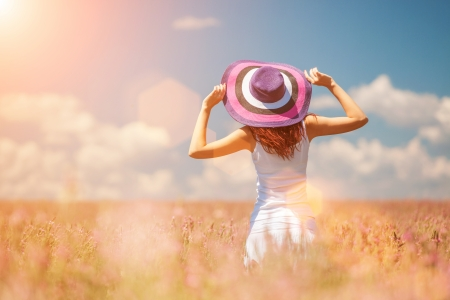 Woman in the field with flowers Archivio Fotografico
