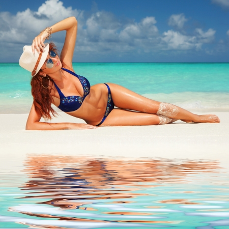 Pretty woman relaxing on the beach photo