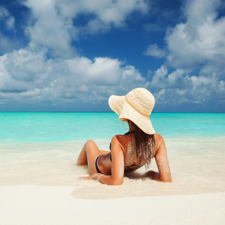 Young fashion woman relax on the beach photo