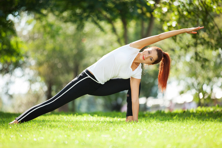 enjoy life: Pretty woman doing yoga exercises in the park