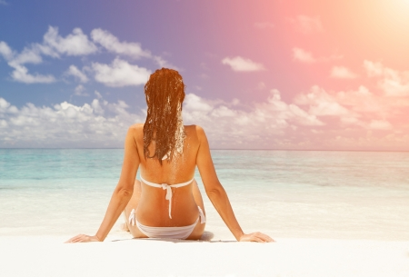 Cute woman relax on the summer beach Stock Photo - 23163787