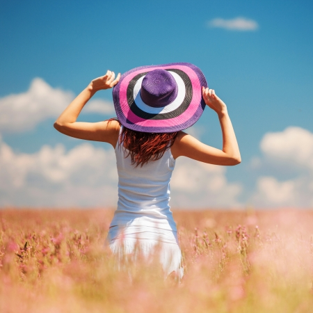 Woman in the field with flowers photo