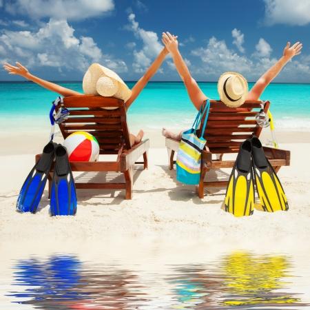 sunbathe: Happy couple on the beach of sea Stock Photo