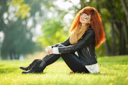 Fashion woman relaxing in the park Stock Photo