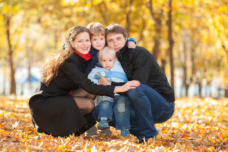 Happy family in the autumn park photo