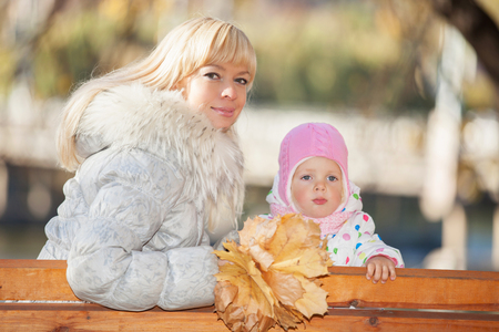 Mother and daughter in the autumn park photo