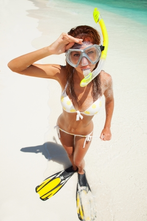Fun woman with snorkeling equipment on the beach Stock Photo